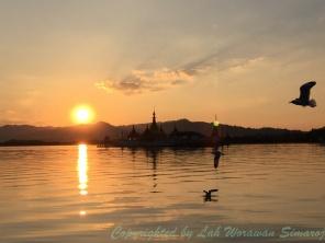 Sunset behind the floating pagoda.